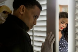 "Michael Ealy looks in on Sanaa Lathan in ""The Perfect Guy"